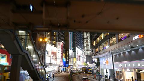 Skyway across night street, pedestrian covered overpass... Stock Video Footage