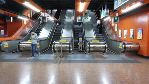 POV walk and enter escalator travel upwards, modern metro station Footage