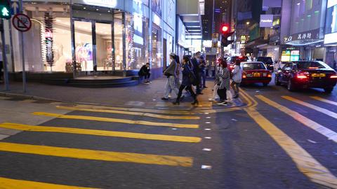 People Cross Night Street, Proceed To Sideway, Blinking Green Light stock footage