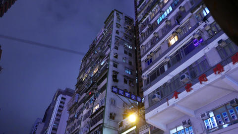 Night old apartment house facade, Hennessy road, twilight time Footage