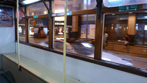 Tram interior, night city sweep outside, modern megalopolis Stock Video Footage