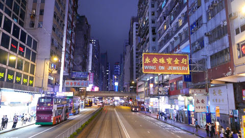 Night city street perspective, chinese signboards, bright shops, dark buildings Footage