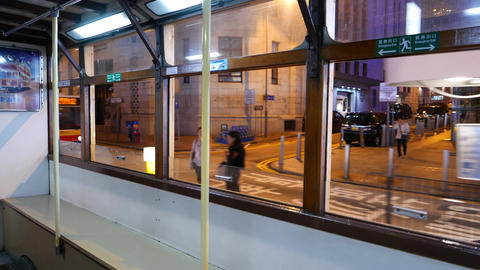 Tramway sweep past outside, night street, view through other tram windows Footage