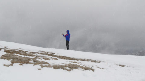 making a selfie on dolomites summit in snow 11764 Stock Video Footage