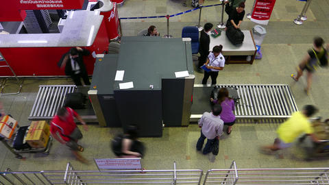 X-Ray security scanner at airport, check passenger baggage, timelapse Footage