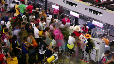 Chinese passengers crowd against check-in counters flight... Stock Video Footage