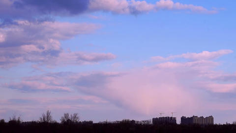 Sunset Clouds over the City Stock Video Footage