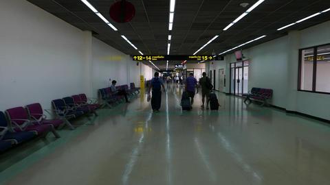 Three passenger walk along terminal passage, POV follow camera walk behind Live Action