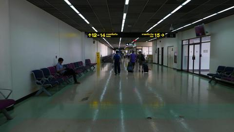 Three passenger walk along terminal passage, POV follow... Stock Video Footage