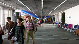 Asian chinese passangers walk through airport passage, POV walking shot Footage