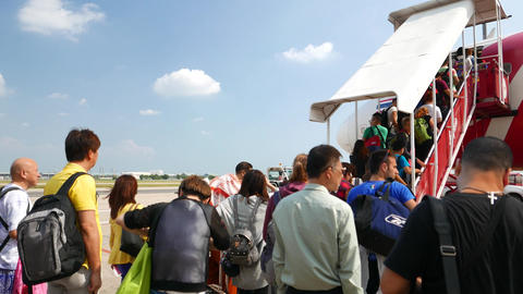 Immovable queue to airplane, climb up movable stairs, POV camera, airport ramp Footage