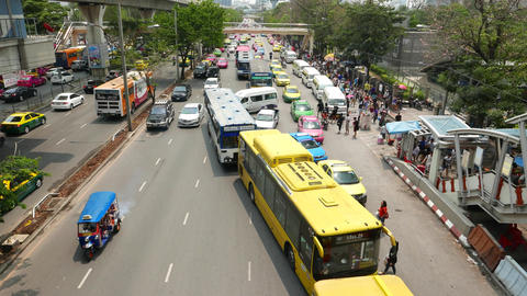 Public bus queue on wide street, create congestion, slide view from above Footage