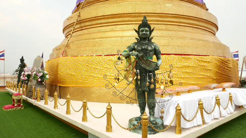 Sculpture guard against golden stupa, front view, Golden Mount, Wat Saket Footage