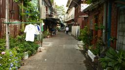 POV camera walk through narrow alley, Sao Chingcha subdistrict Footage