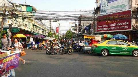 Police officer on motorcycle, talk to scooter driver, Khao San road intersection Footage