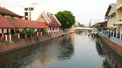 City canal, high decorated pedestrian area on bank, traditional style Footage