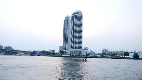 Long tail boat float away, Chao Phraya river in twilight time Footage