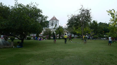 Children people rest and recreate in park, twilight time, dolly shot Footage