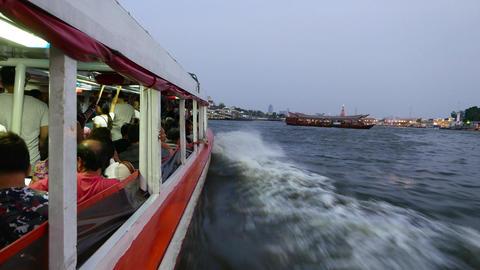 Travel within express boat full of passengers, lean out the hull, dusk river Footage