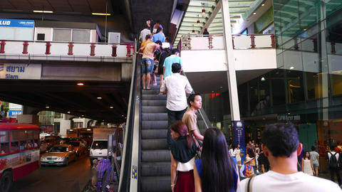 POV camera travelling upwards outdoor escalator to Siam BTS station Footage