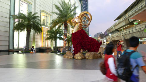 Golden ram statue, decorated with red flowers, luxury mall square decoration Footage
