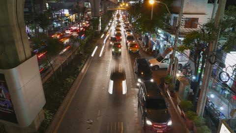 Crowded traffic accumulate to blockage at night city road, TIMELAPSE from above Footage