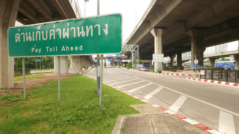 Toll Gate Ahead Green Road Sign, Thai Language, Dolly Shot Camera Move Forward stock footage
