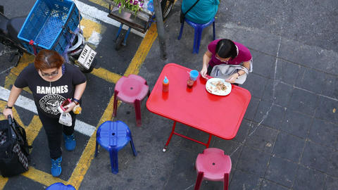 Woman Eat Thai Rice Based Meal At Cheap Eatery On The Street, View From Above stock footage