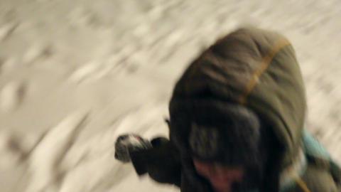 A little boy runs through the snow Footage