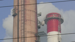 Smoking chimneys of a coal power plant. Close up Footage