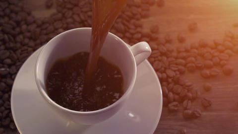 Pouring coffee surrounded by coffee beans Footage