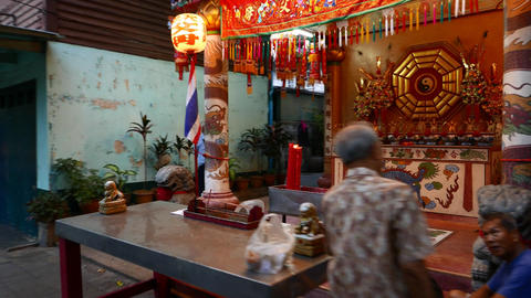 Traditional Chinese shrine place at dusk Bangkok street, quick parallax shot Footage