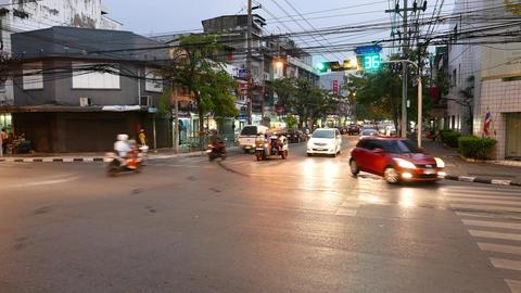Vivid lights at road intersections, dusk and bright illumination Footage