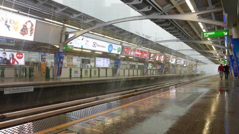 Heavy shower streams, overground metro platform of BTS Nana station Footage