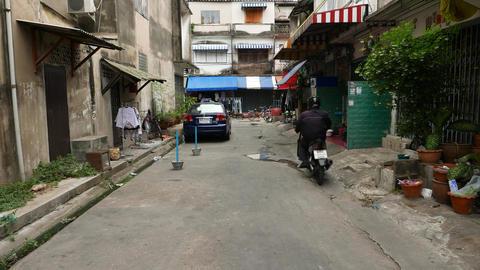 Old slum-like maisonette residential area, modern apartments tower on background Footage