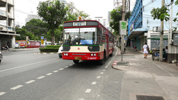 Noisy daytime traffic at Rama IV road, public bus loudly drive aside Footage