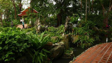 Grotesque creatures sculpture at Himmapan garden, glide camera movement Live Action