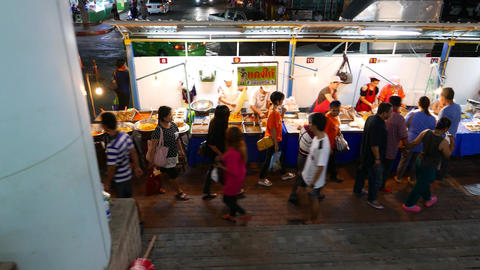 Asian Women Walk Aside Street Food Stalls, Evening Time, Track Shot stock footage