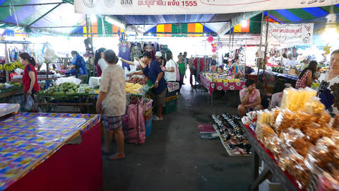 Rare visitors at covered bazaar, fruit and vegetable stalls, dry foods Footage
