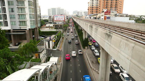 Sukhumvit road traffic semi-aerial view from above carriageway, BTS line Footage