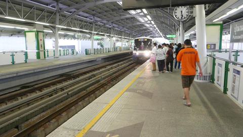 Metro train arrive, people loading into, POV camera come inside Footage