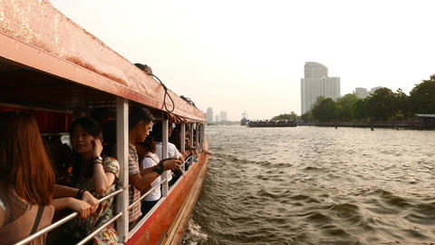 Asian people travelling on boat, girl talk, young man take picture, outside view Live Action