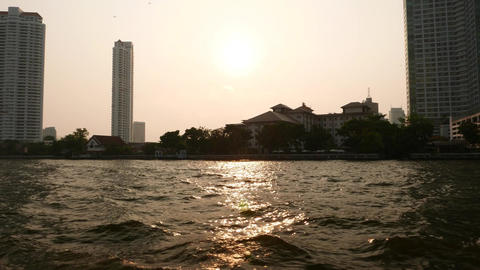 Several Tall Towers Silhouette As Seen From Water, Sunny Evening stock footage