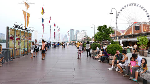 Tourists Rest And Take Pictures On Modern Riverside Promenade, Evening Time stock footage