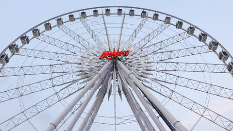 Big Observation Wheel Against Evening Sky, Light Illumination, Tilt Down Shot stock footage