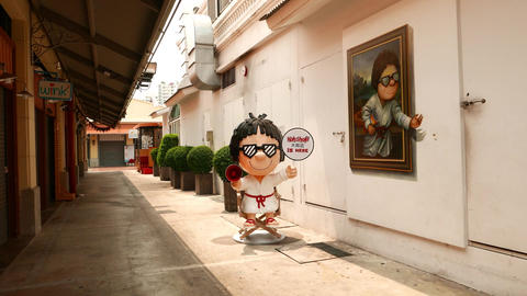 Empty alley at Asiatique, camera move through passage, creative painting aside Footage
