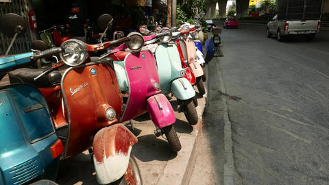 Classic Vespa motor scooters second hand sale at Bangkok street, glide shot Live Action