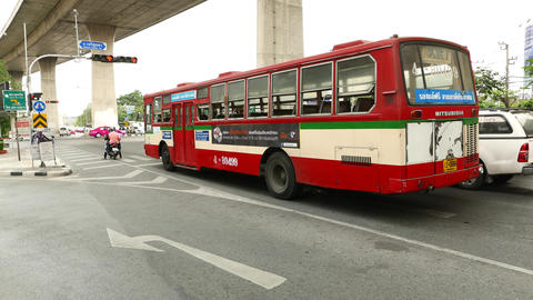 Old red bus standing on red traffic light, free route at Mahai Sawan street Footage