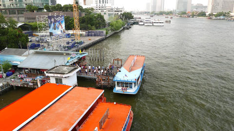 Commuters alight from ferry boat, walking out to floating pier platform Footage