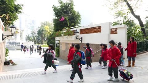 Group of schoolchildren in a park in Hong Kong 動画素材, ムービー映像素材
